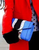 Statement blue clutch and red coat add up to the perfect Winter pairing.