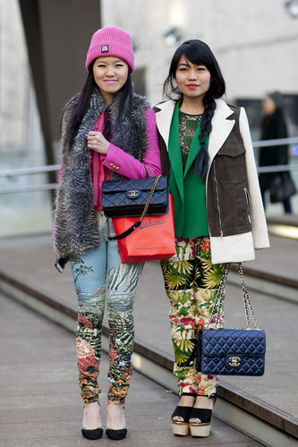 Enviable bags and statement-print pants united this duo outside the tents.