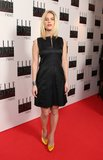 Alice Eve paired her little black dress with yellow satin pumps and a silver cuff bracelet.