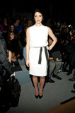 Ashley Greene accessorized her white sheath with a black belt and matching patent pumps at Kaufman Franco.