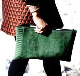 We love the slick nature of this forest green suede clutch.