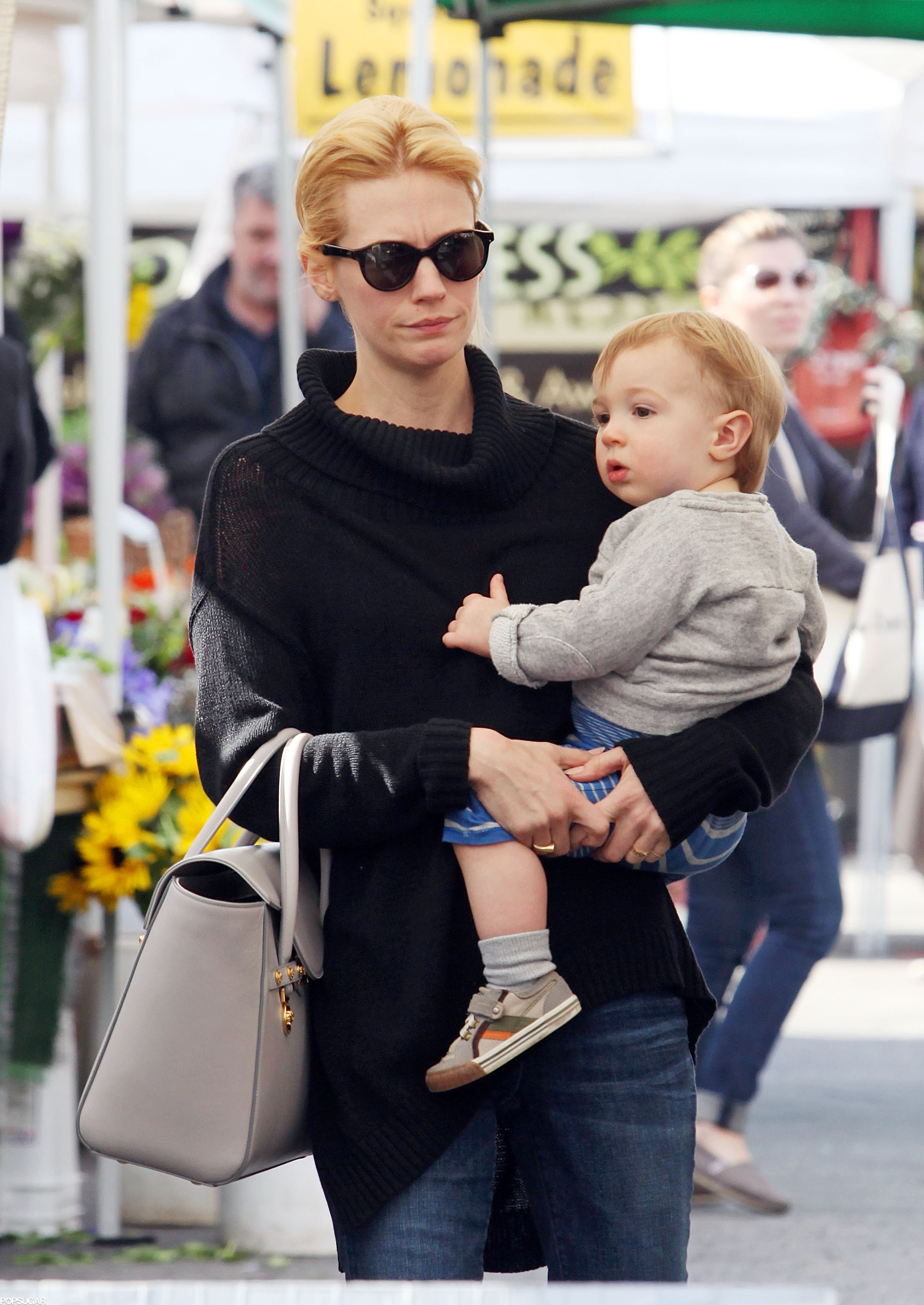 January Jones stopped by an LA farmers market with son Xander Jon