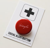 "When meeting up with your single friends for a drink on Valentine's Day, don't come empty-handed. Pass out these ""single"" social alert buttons ($3)."
