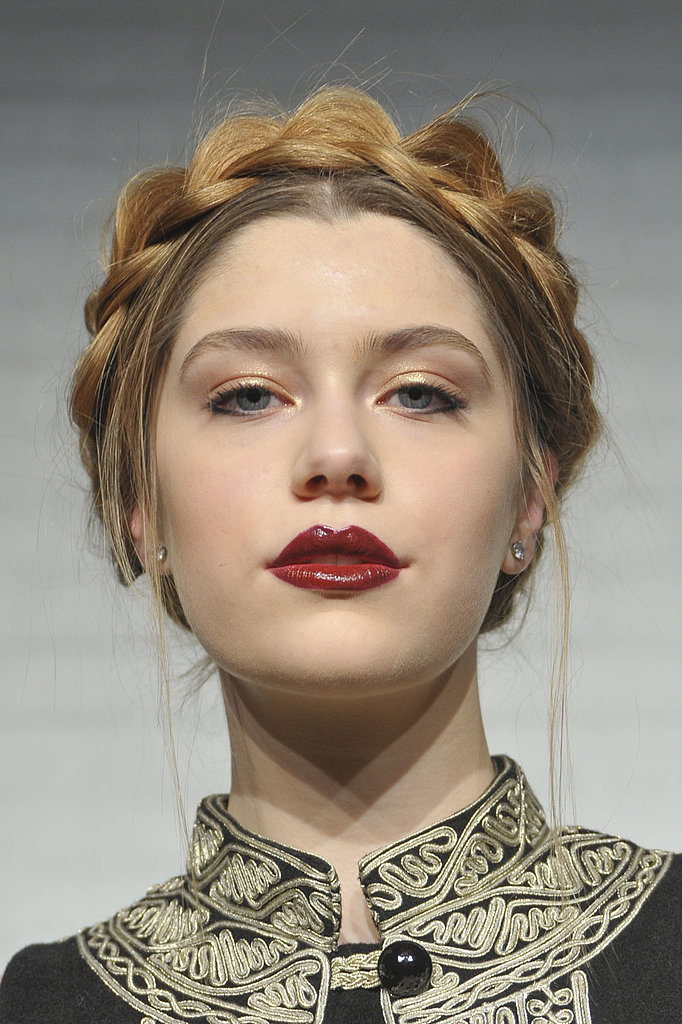 Gilded eyes are the perfect complement to a saturated red lip, like this look from Alice + Olivia's Fall presentation.
