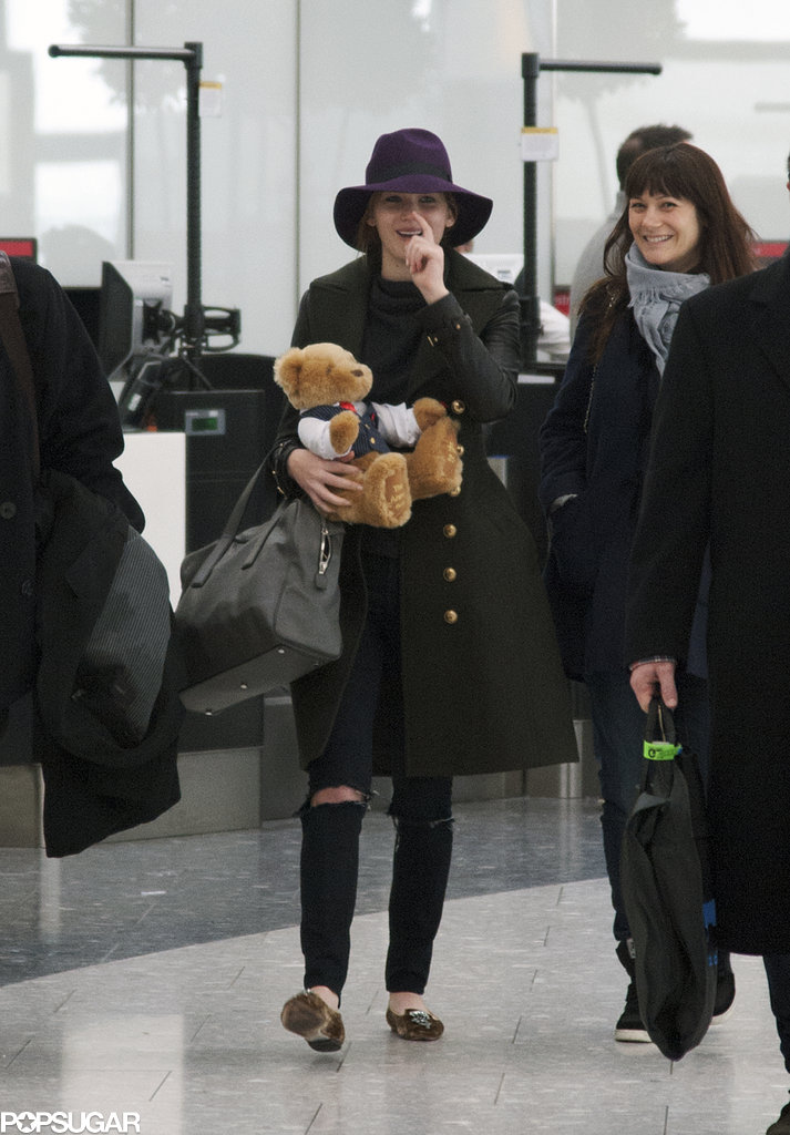 Jennifer Lawrence carried a teddy bear while making her way through Heathrow Airport