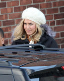 Jennifer Aniston wore a white hat over her blond wig on set.