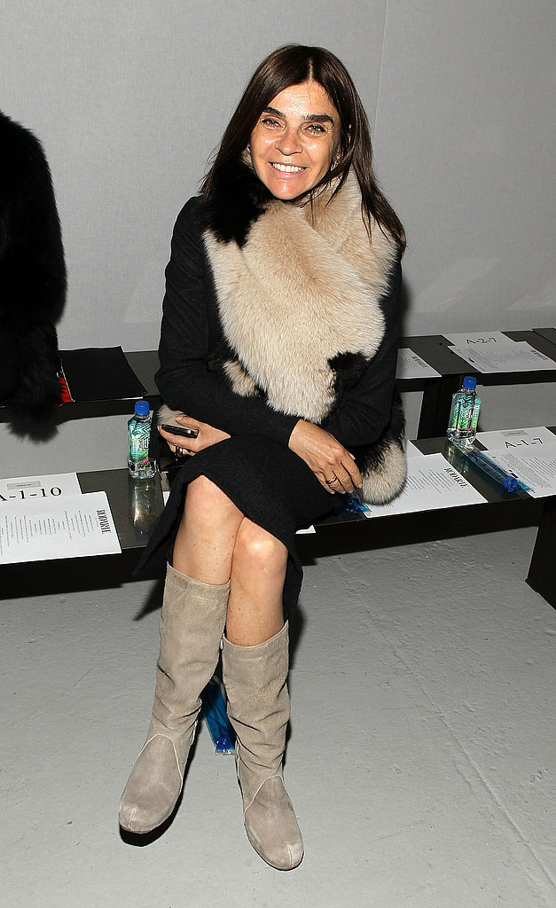 Carine Roitfeld worked a fur stole while perched front row at Rodarte.
