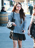 Selena Gomez wore a loose sweatshirt and a skirt.