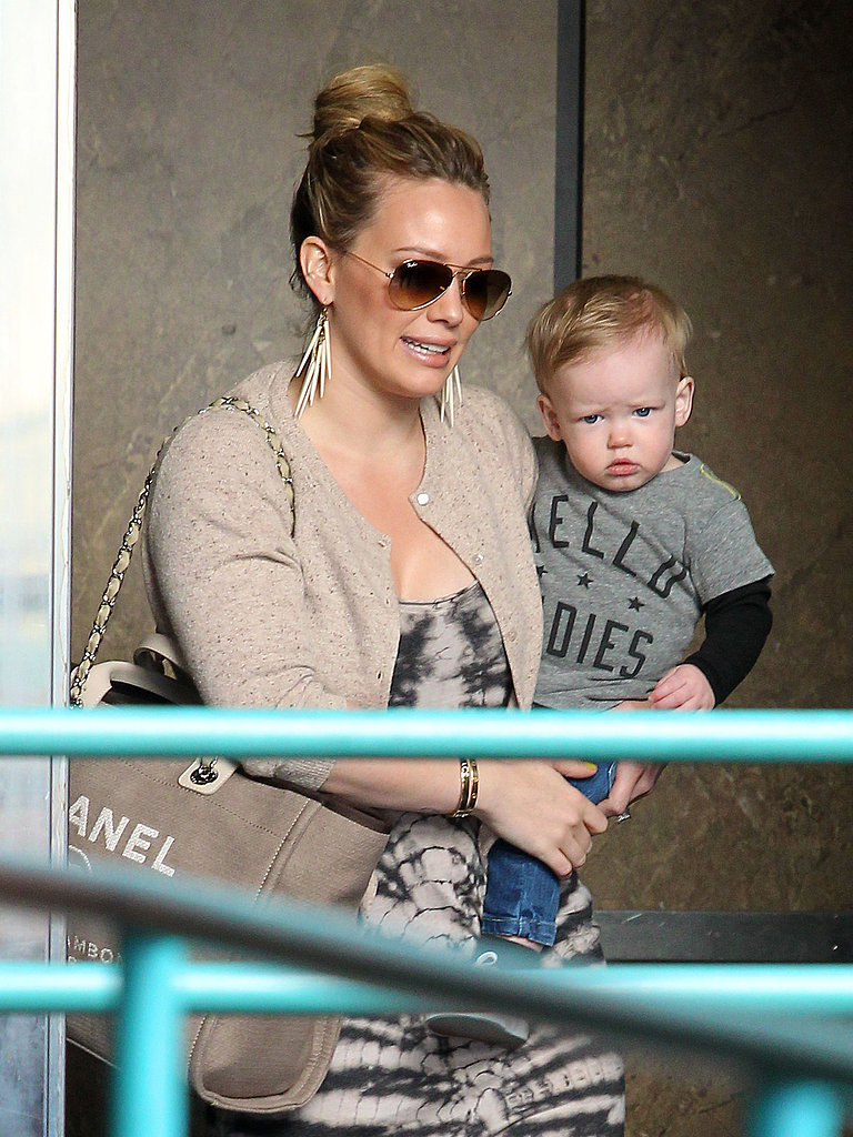 Hilary Duff carried Luca as the mother-son duo made their way through LA.