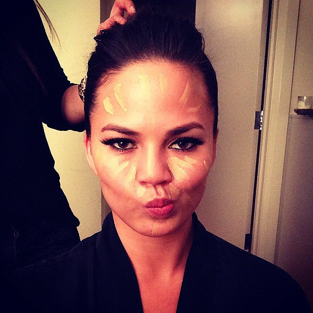 Chrissy Teigen snapped a photo while getting her makeup done. Source: Instagram user chrissy_teigen