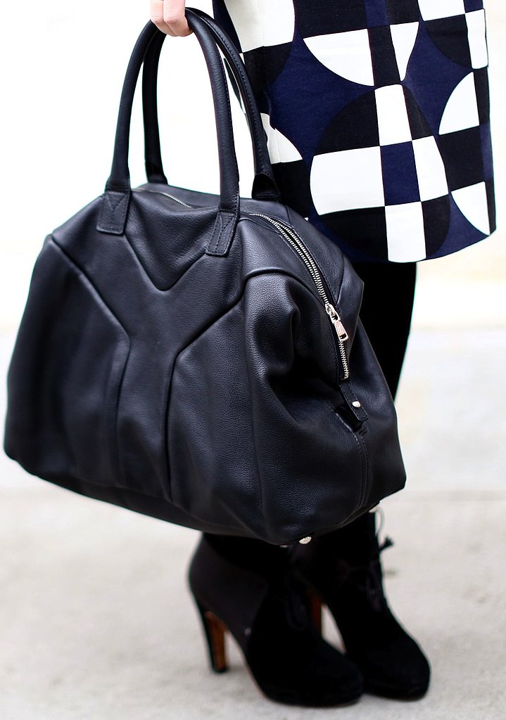 Yves Saint Laurent's duffel tote adds a sporty edge to this monochrome look.