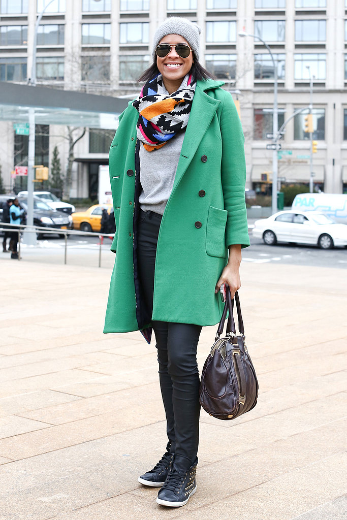 Echo your big, bright pieces — like this brilliantly-hued statement coat — with a great accessory, like her multihued print scarf.