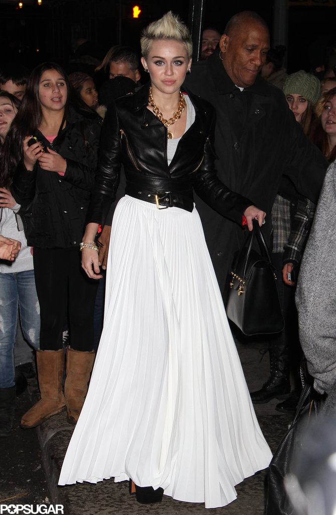 Miley Cyrus wore a white maxi skirt to her Cosmopolitan cover party in NYC.