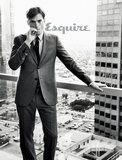 Ashton Kutcher posed in front of a floor-length building window for Esquire's March issue.