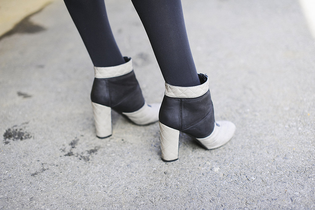 Tow-toned booties — with a contrasting pop of white — looked just right against black tights.