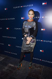 Jennifer Lopez shimmered in a metallic printed dress paired with black tights and equally eye-catching printed sandals.