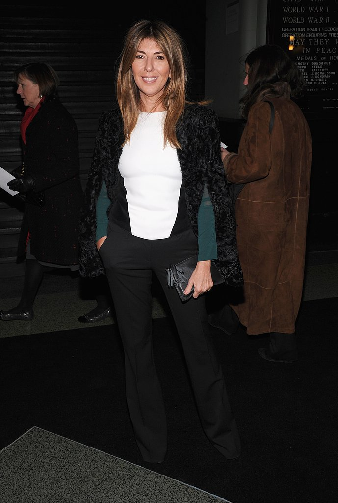 Nina Garcia wore black trousers with a white top and a black shearling cape at Marc Jacobs.