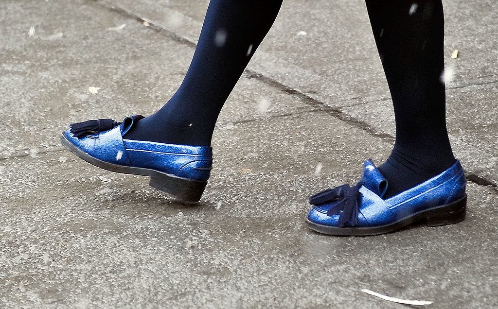 Metallic loafers added high shine to black tights.