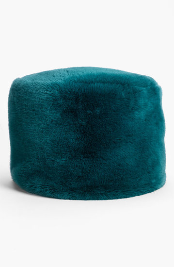 Create your own front-row seating with this teal-green faux-fur poof ($79, originally $118).