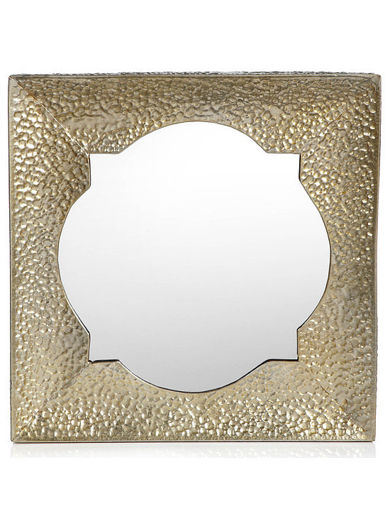 You won't have trouble finding a place off the runway for this lovely textured gold mirror ($50).