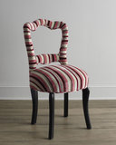 A charming candy-striped chair ($969) is both sweet and funky — just like the Anna Sui collection.