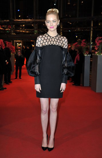 Mod met glam when Emma Stone showcased a little black dress with poufy sleeves and a netted bodice at the Croods premiere at the Berlin Film Festival. She completed her red-carpet style with black pumps, Jamie Wolf earrings, and a Graziela ring.