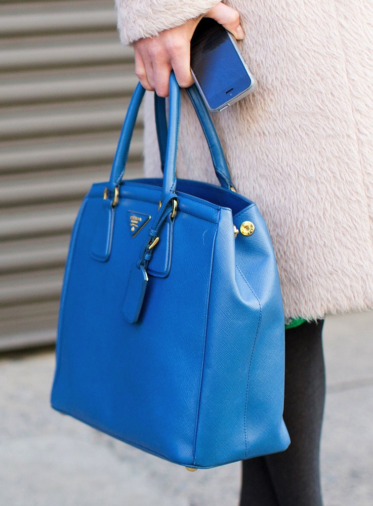We love the bright blue hue on this ladylike Prada tote.