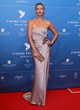Charlize Theron glowed in a strapless Gucci gown at the Cinema For Peace gala in Berlin.