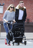 Sienna Miller smiled as she took Marlowe for a walk in her stroller.