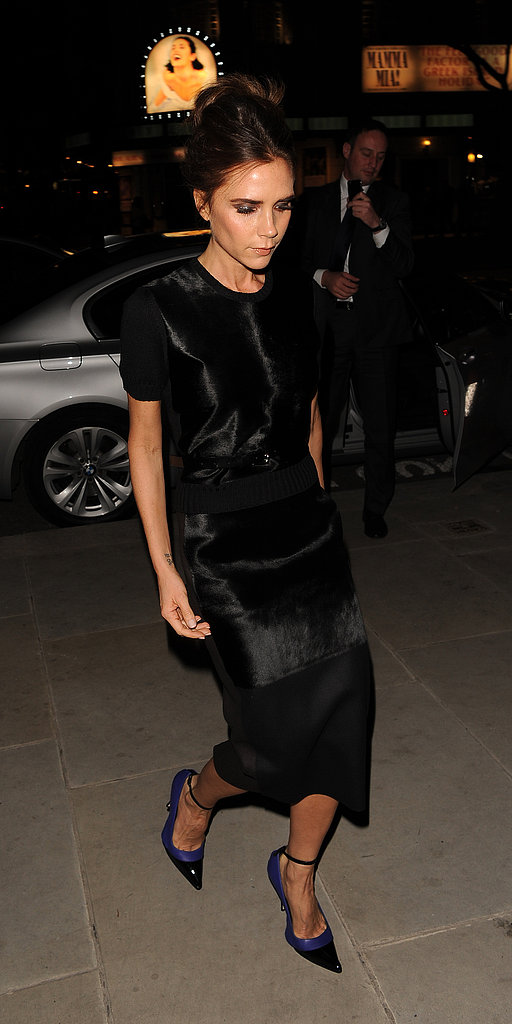 Victoria Beckham wore a black dress with fur embellishments and blue heels in London.