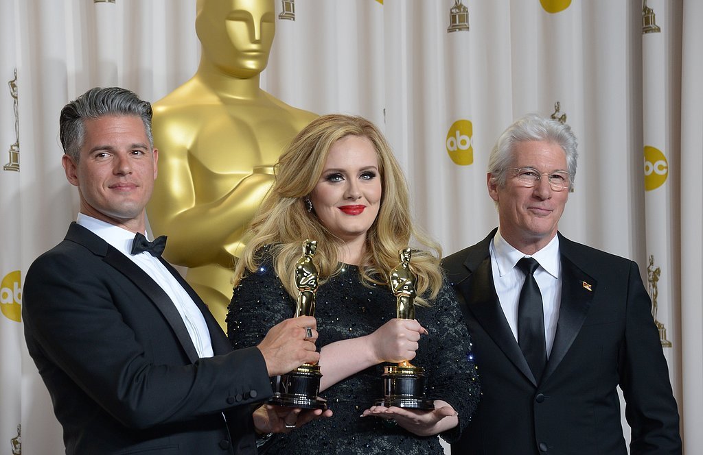 Adele posed with her Oscar in the press room.