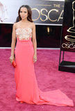 Kerry Washington dazzled in a coral Miu Miu number at the Oscars.