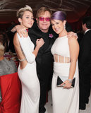 Elton John was sandwiched between Miley Cyrus and Kelly Osbourne at his Oscar party in LA.