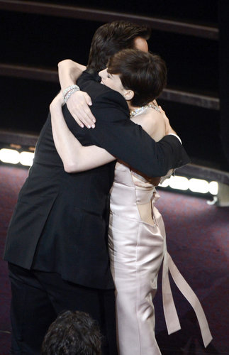 Anne Hathaway and Hugh Jackman hugged in the audience.