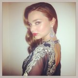 Miranda Kerr shared an over-the-shoulder pose on Oscar night. Source: Instagram user mirandakerrverified