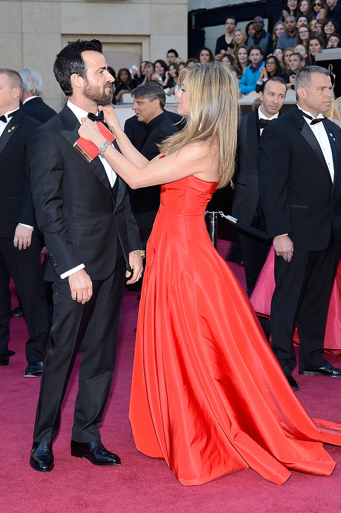 Jennifer Aniston straightened out Justin Theroux's bowtie.