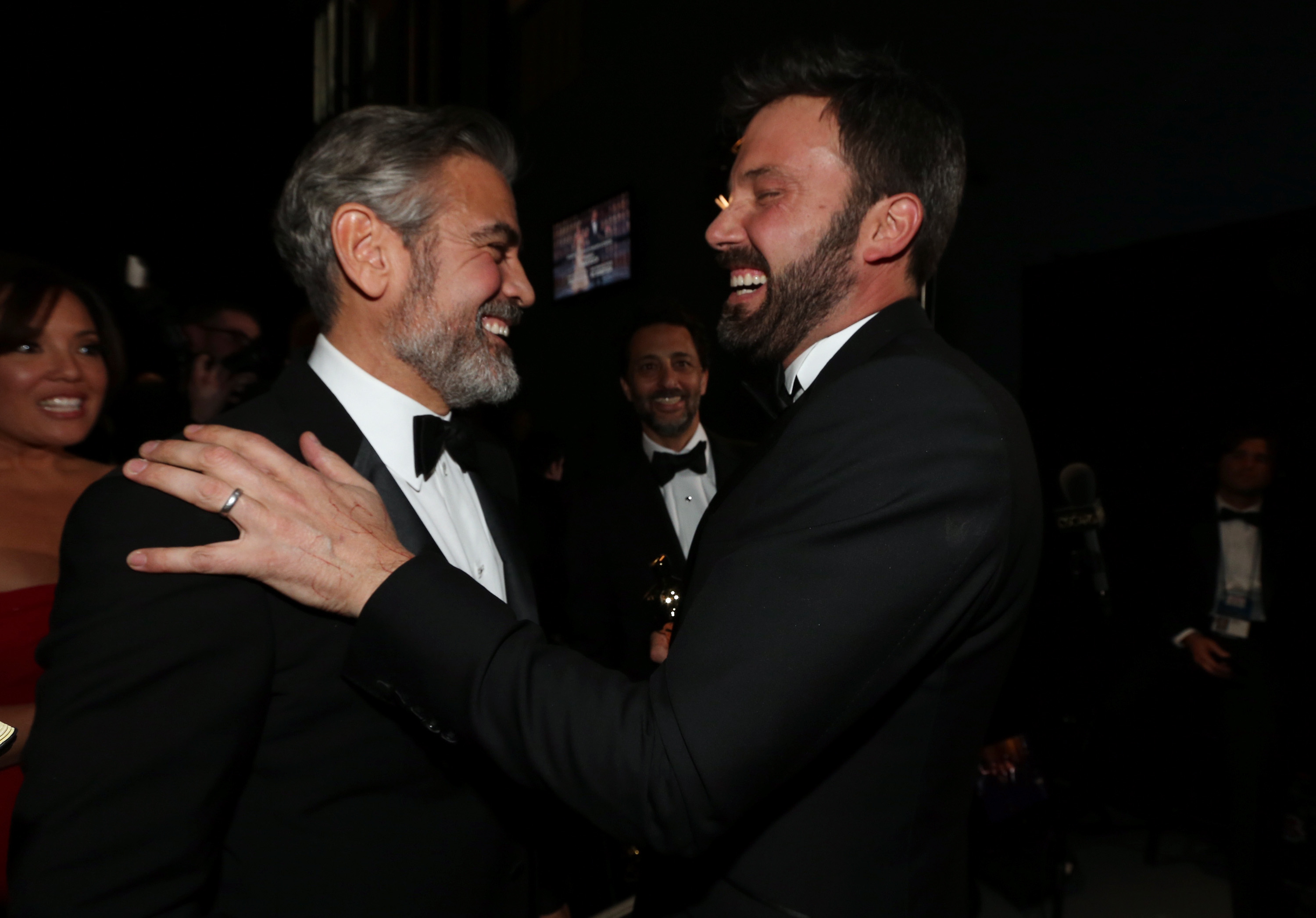 Ben Affleck and George Clooney backstage at the 2013 Oscars.
