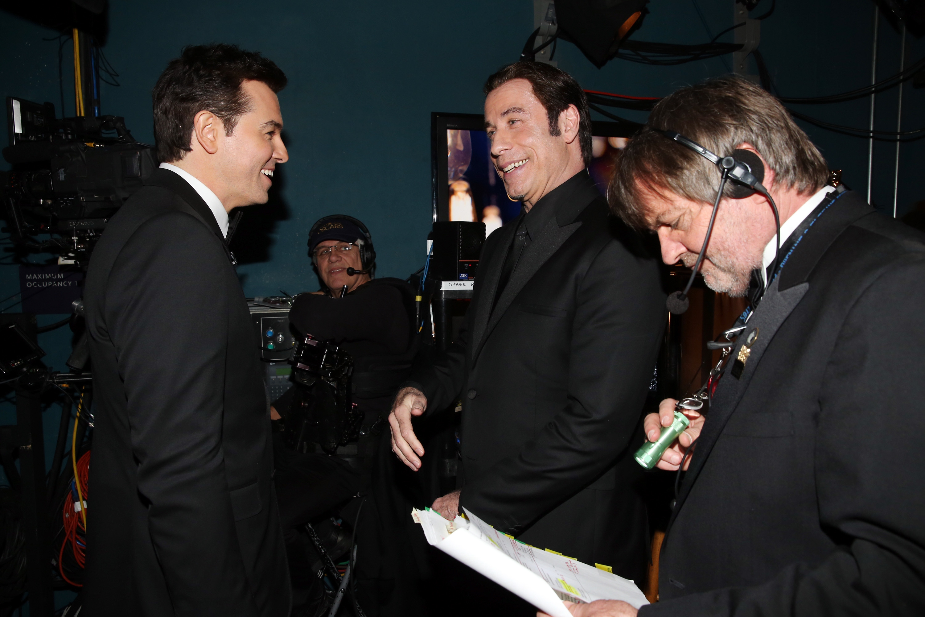 Seth MacFarlane and John Travolta backstage at the 2013 Oscars.