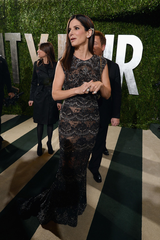 Sandra Bullock arrived at the Vanity Fair Oscar party on Sunday night.