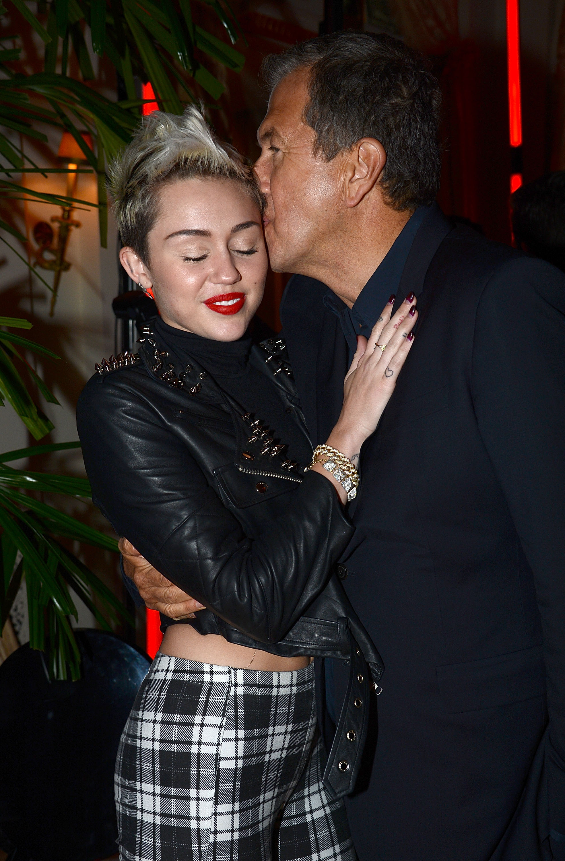 Miley Cyrus and Mario Testino shared a hug at the party for his PRISM exhibit.