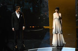 Anne Hathaway and Hugh Jackman on stage at the Oscars 2013.