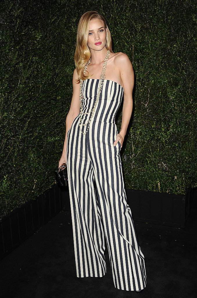 Rosie Huntington-Whiteley stunned in vertical stripes — a black-and-white Spring '13 Chanel jumpsuit, to be exact.