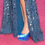 Jennifer Hudson completed her blue embellished Roberto Cavalli gown with equally shiny blue snakeskin peep-toes.