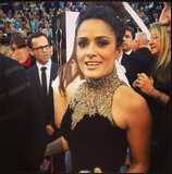 Salma Hayek went with a high neckline, courtesy of Alexander McQueen. Source: Instagram user theacademy