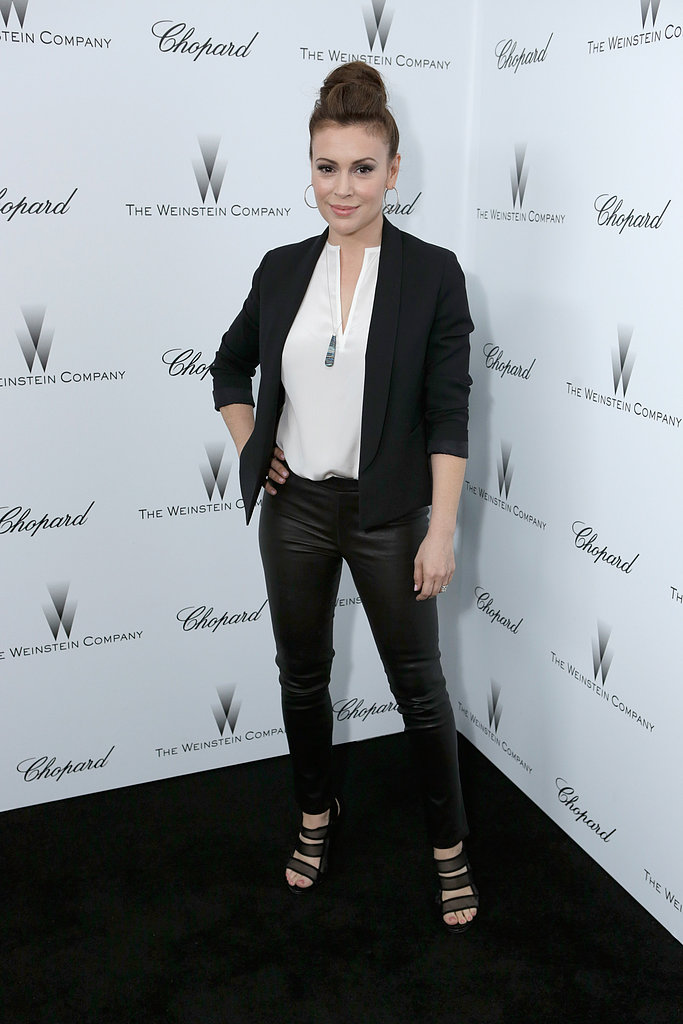 Alyssa Milano sported black leather pants with a white blouse and black blazer for a more laid-back approach to party-wear.