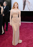 Jessica Chastain channeled Old Hollywood glamour in a light copper custom Armani Privé gown with a Swarovski crystal overlay.