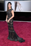 Sandra Bullock — mom to Louis —wore a black lace Elie Saab gown on the Oscars red carpet.