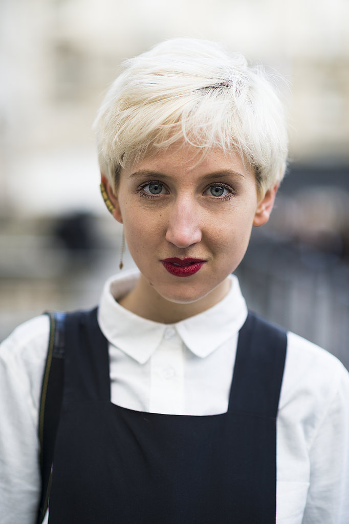 Snow-white-hued pixies must be the popular cut in London — Alice Tate updated hers with a classic red lip. Source: Le 21ème | Adam Katz Sinding