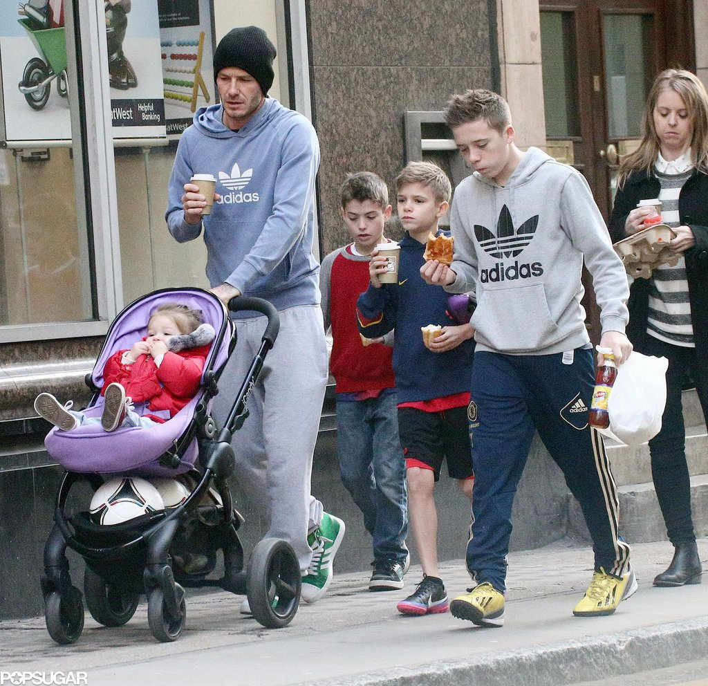 David Beckham walked with his kids, Brooklyn, Cruz, Romeo, and Harper, in London.