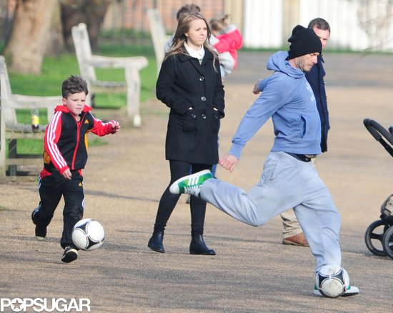 David Beckham kicked a soccer ball with his kids.